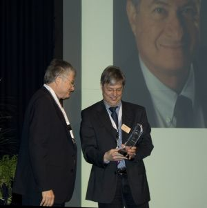 EDAA Award presented by Norbert Wehn to Mel Breuer